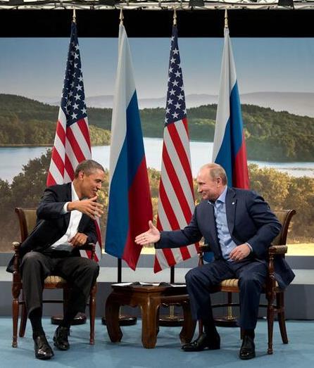 Cropped_Barack_Obama_and_Vladmir_Putin_shake_hands_at_G8_summit,_2013